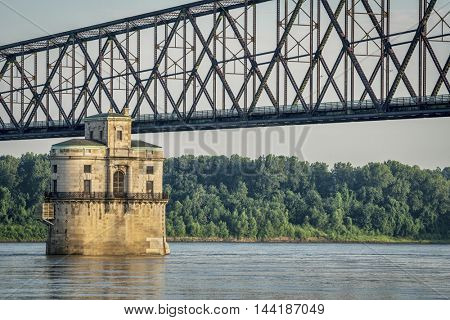 Historic water intake tower number 2 built in 1915 and the Old Chain of Rocks bridge on the Mississippi River above St Louis