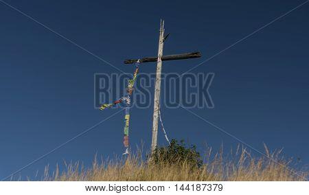 Cross on Velky Spicak hill in Krusne hory mountains