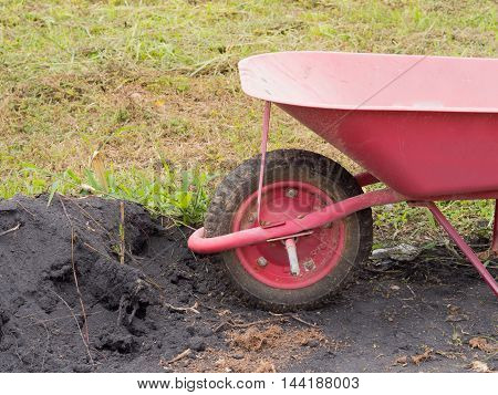 red Cart Dumpers And Soil pile .