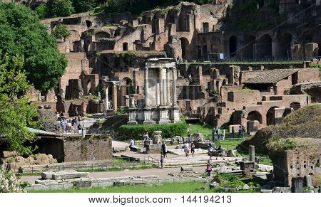 ROME, ITALY - MAY 25: Tourists visit the famous Temple of Vesta in the center of Roman Forum MAY 25, 2016 in Rome, Italy