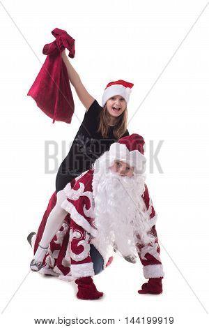 Happy girl sitting astride a Santa Claus