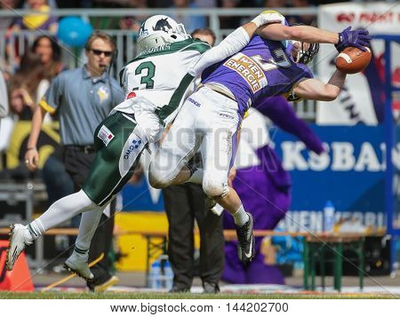 VIENNA, AUSTRIA - MAY 17, 2015: CB Nathaniel Morris (#3 Unicorns) tackles WR Dominik Bundschuh (#3 Vikings) in a game of the Big Six Football League.