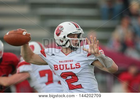 VIENNA, AUSTRIA - MAY 9, 2015: QB Maximilian Oberndorfer (#2 Bulls) throws the ball in a game of the Division II of the Austrian Football League.