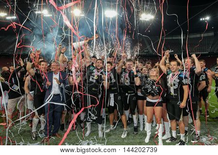 KLAGENFURT, AUSTRIA - JULY 11, 2015: The team of the Raiders celebrate their victory after a game of the Austrian Football League.