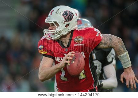 INNSBRUCK, AUSTRIA - MAY 2, 2015: QB Grant Enders (#14 Lions) runs with the ball in a game of the Big SIx Football League.