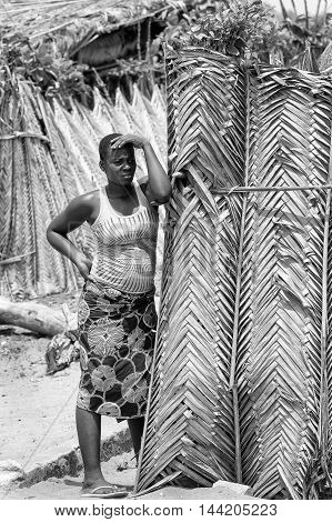 KARA, TOGO - MAR 9, 2013: Unidentified Togolese woman stays near a house. People in Togo suffer of poverty due to the unstable econimic situation