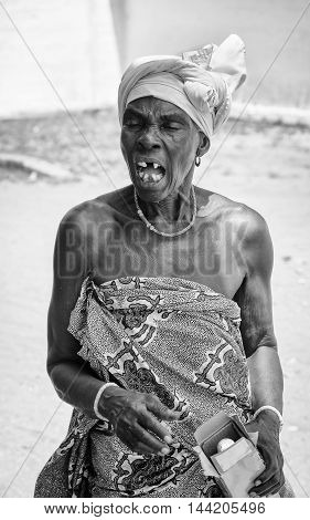 KARA, TOGO - MAR 9, 2013: Unidentified Togolese angry woman creams. People in Togo suffer of poverty due to the unstable econimic situation