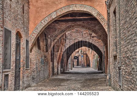 Ferrara, Emilia Romagna, Italy: the picturesque arched alley Via delle Volte, ancient medieval street