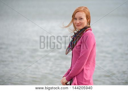 Outdoor portrait of a beautiful woman on the background of the sea