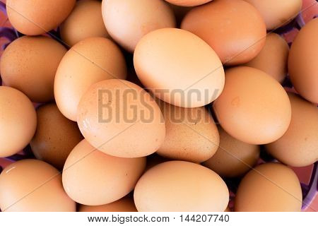 Close of Fresh Chicken Egg ,Eggs.Many fresh yellow chicken eggs in group