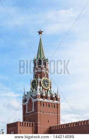 Moscow, Russia - July 07, 2016: Kremlin Spasskaya tower with a bell tower a star and the Courant Clock (big clock)