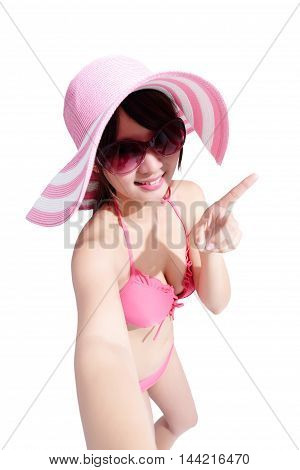 beauty woman wear bikini and show something happily with isolated white background asian