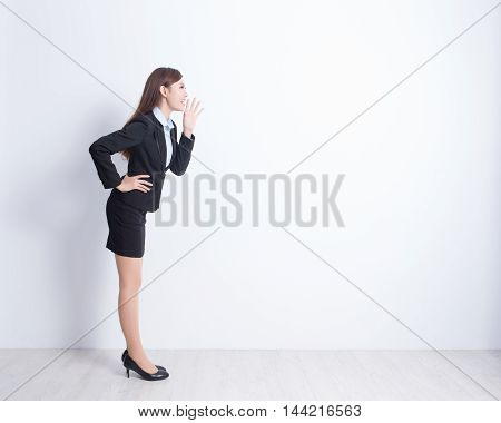 business woman shouting with white wall background great for your design or text asian