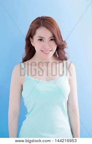 Beauty woman with charming smile to you with health skin and hair isolated on blue background asian beauty