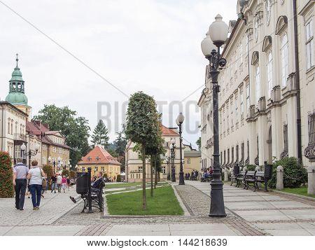 JELENIA GORA POLAND - AUGUST 14 2016: Tourists Walking Through Historic Downtown in Warmbrunn Jelenia Gora Poland