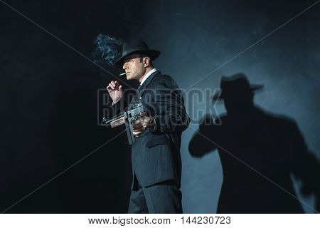 Retro 1940S Film Noir Gangster With Gun Smoking Cigarette.