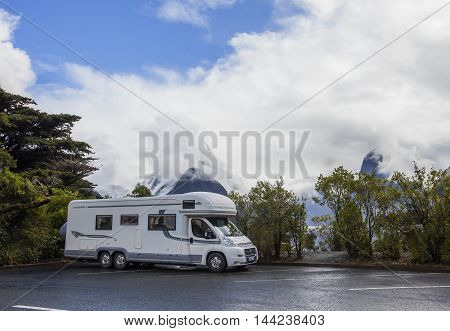 MILFORD SOUND NEW ZEALAND-AUGUST 30 : camper van in car park lot of milford sound fiord land national park important destination to traveling on august 30 2015 in Milfordsound New Zealand