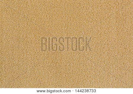 Closeup detailed texture of new and clean floor rug, doormat in beige color