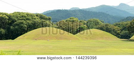Gyeongju, South Korea - August 17, 2016: Tumulus Located In Gyeongju, South Korea. The Tomb Was For