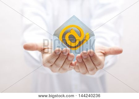 Email symbol with envelope in hands