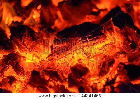 Closeup view of hot smoldering red coals