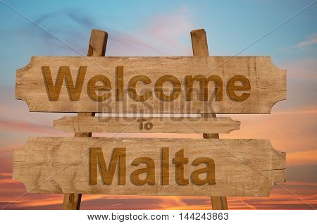 Welcome To Jamaica Sign On Wood Background With Blending National Flag