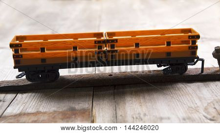 Toys car of the train on old boards background