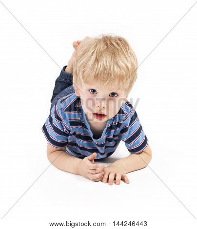 Beautiful child. Child lies on a white background and looks forward