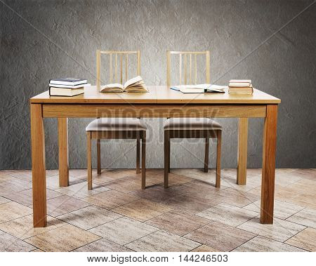 Table for reading with books and laptop. Education concept.