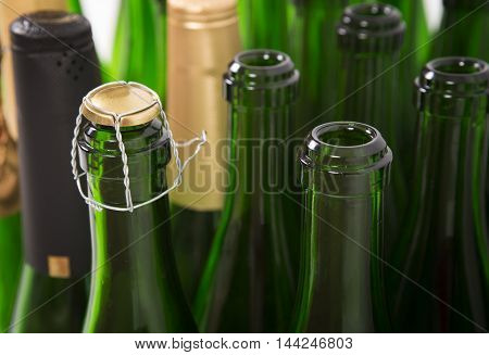 Bottles of champagne background. Capsules of a bottle of champagne background. Packing production. Alcoholic production