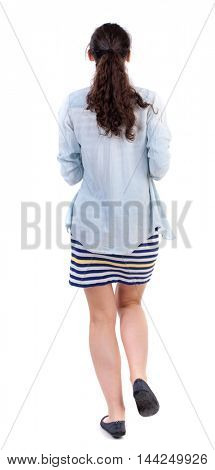 back view of running  woman. beautiful girl in motion. backside view of person.  Rear view people collection. Isolated over white background. Swarthy girl in a checkered dress on a jog.