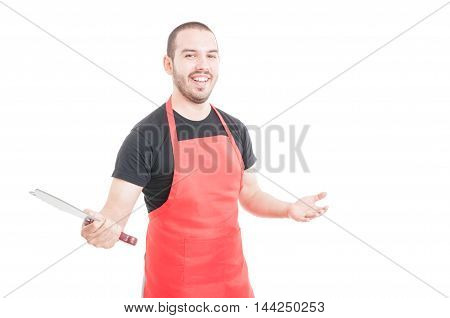 Cheerful butcher with red apron holding sharp chopper isolated on white background