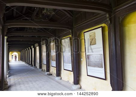 Hue, Vietnam - Jun 16, 2016: Historic paper exhibited on the wall of Forbidden City of the Imperial Royal Palace of Nguyen dynasty. This is recognized as World Cultural Heritage site by UNESCO.
