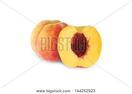 whole and half peach with stone isolated on white background with clipping path