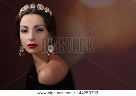 brunette in a luxury jewelery with confident eyes