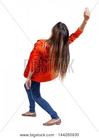 Balancing young woman. or dodge falling woman. girl in a red jacket bends back.