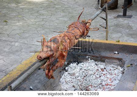 Roast suckling pig on a spit in Cienfuegos Cuba.