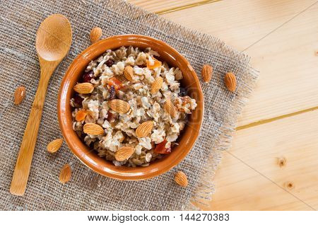 Serving Muesli Scattering Of Nuts On Wooden Table