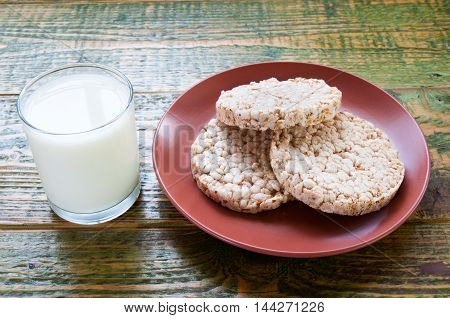 Glass Of Milk With Crispbread On Clay Plate