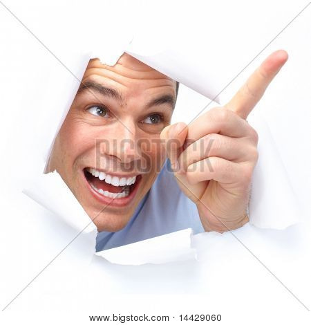 Cute young man smiling looking through a hole