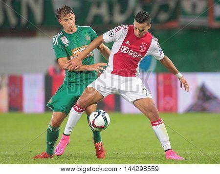 VIENNA, AUSTRIA - JULY 29, 2015: Stefan Schwab (SK Rapid) and Anwar El Ghazi (Ajax) fight for the ball in an UEFA Champions League qualification game.