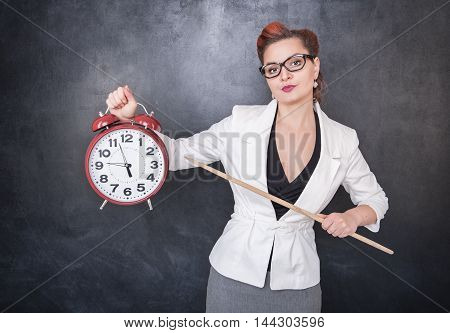 Beautiful Strict Teacher With Clock
