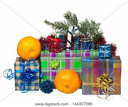 Holiday gift boxes with Christmas toys isolated on white background