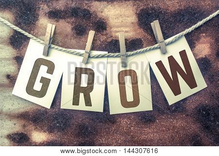 Grow Concept Pinned Stamped Cards On Twine Theme