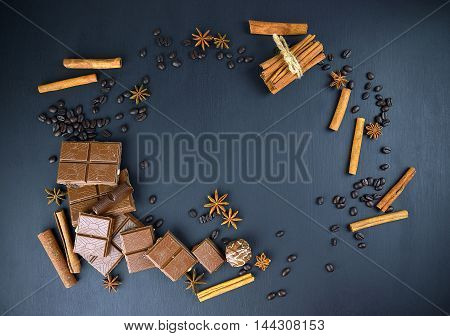 Sweet Dreams. Chocolate coffe grain cinnamon Badia candy on a dark background. Top view. holiday atmosphere. poster