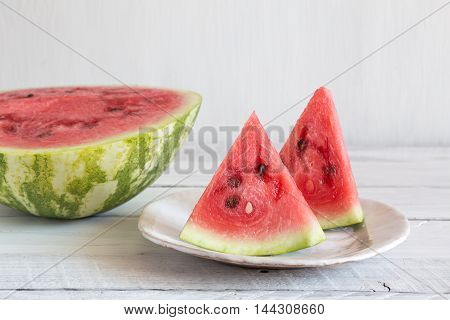 watermelon pieces in a ceramic bowl red juicy watermelon on a white background ceramic bowl with slices of watermelon