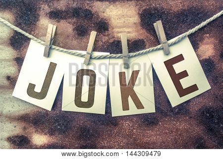 Joke Concept Pinned Stamped Cards On Twine Theme