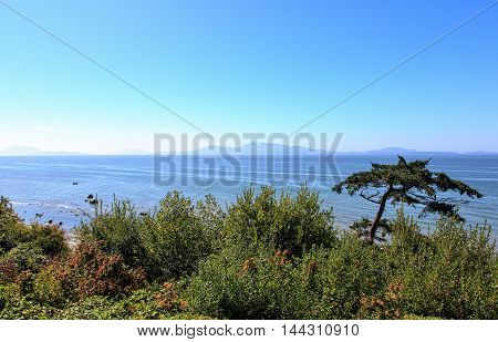 View from Point Whitehorn, Birch Bay, Washington looking across the strait at the San Juan Islands and Canada