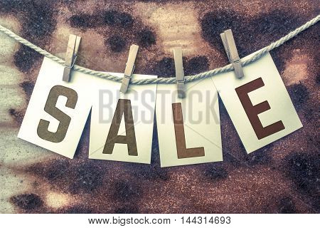 Sale Concept Pinned Stamped Cards On Twine Theme