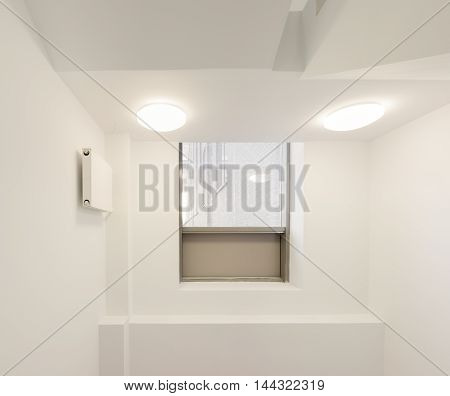 Stairwell in modern office building with window